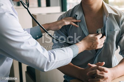 istock Asian doctor is using a stethoscope listen to the heartbeat of the elderly patient. 1126835434
