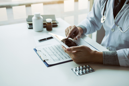 873418972 istock photo Asian doctor using the tablet explaining the patient condition and the treatment result. 1220263203