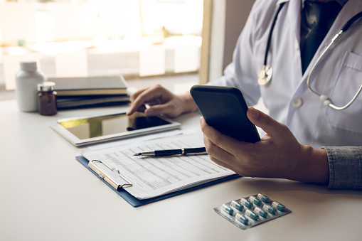 873418972 istock photo Asian doctor using the tablet explaining the patient condition and the treatment result. 1221109653