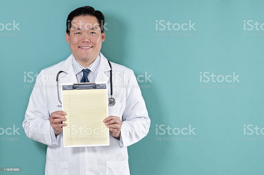 Asian Doctor With Clipboard royalty-free stock photo