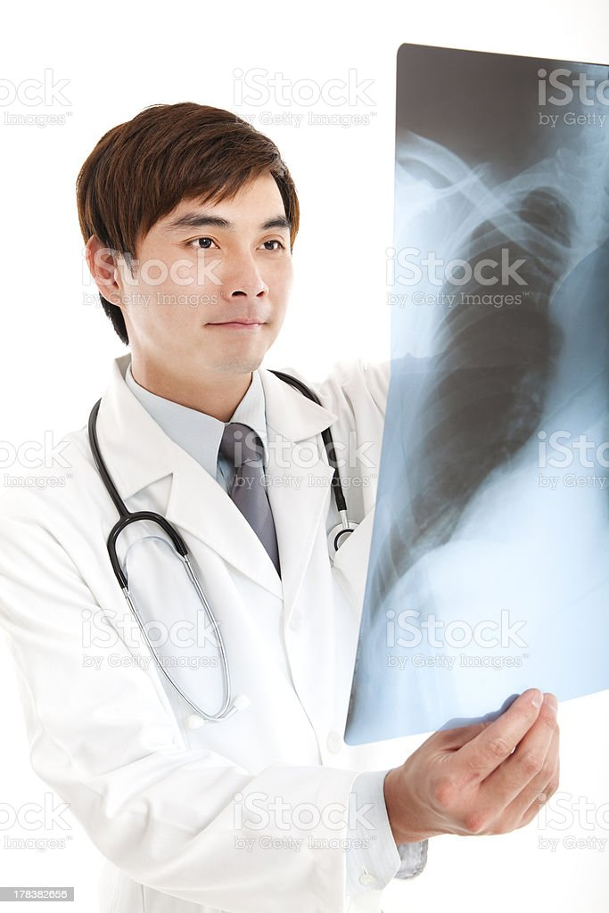 asian doctor with x-ray royalty-free stock photo
