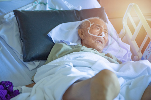 1049772134 istock photo Asian elder man sick and have tube in hospital ward,sleep in coma state on bed 1171646479