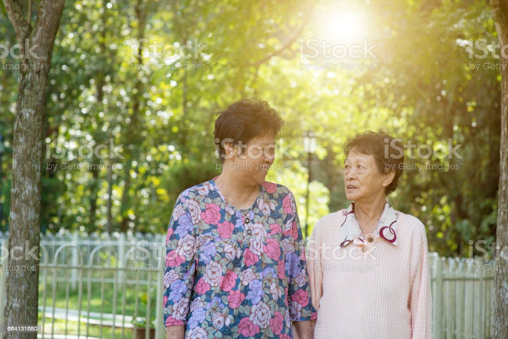 Asian elderly women morning exercise, walking at outdoor foto stock royalty-free