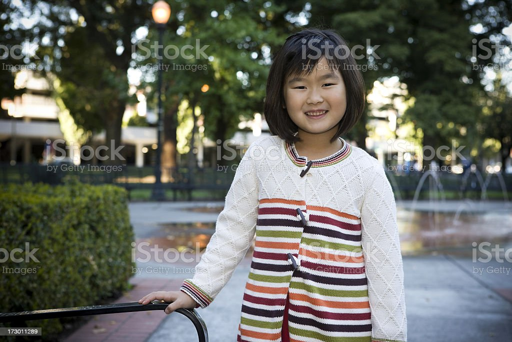 Asian Elementary Age Girl Portrait at Outdoor Park, Smiling, Copyspace royalty-free stock photo