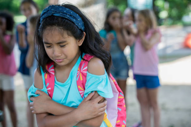 asian elementary age little girl cries while being teased at school - philippines girl stock photos and pictures
