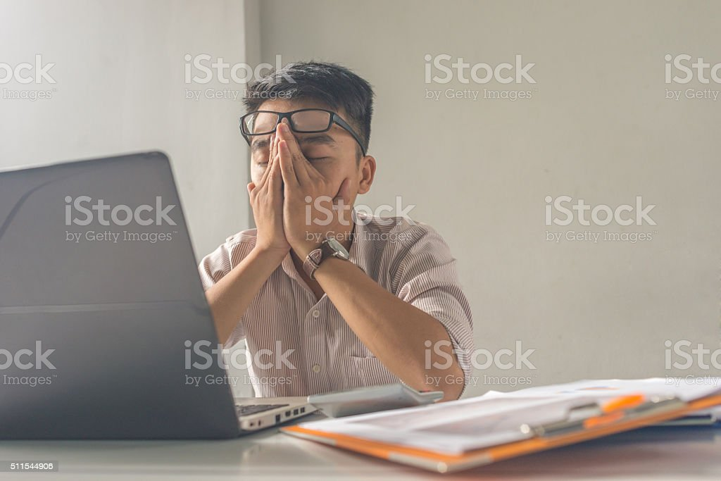 Asian employee take a nap after working under high pressure stock photo