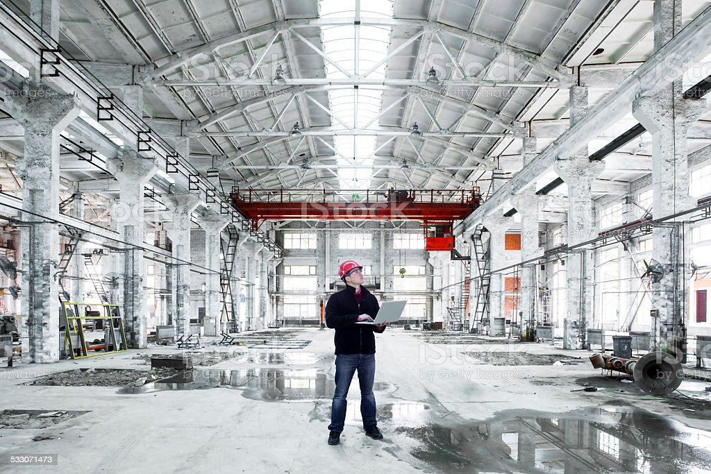 asian engineer in factory interior