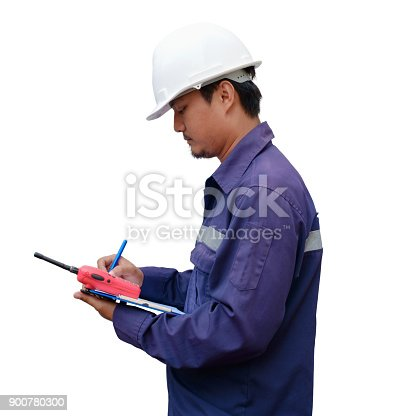 istock Asian engineer in safety uniform and white helmet taking note on clipboard isolated on white background for industrial concept 900780300