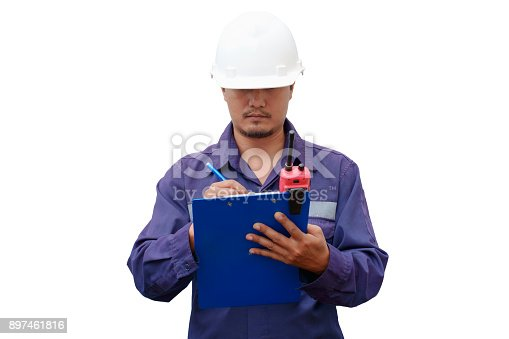 istock Asian engineer in safety uniform taking note on clipboard 897461816