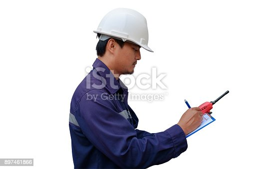 istock Asian engineer in safety uniform taking note on clipboard 897461866