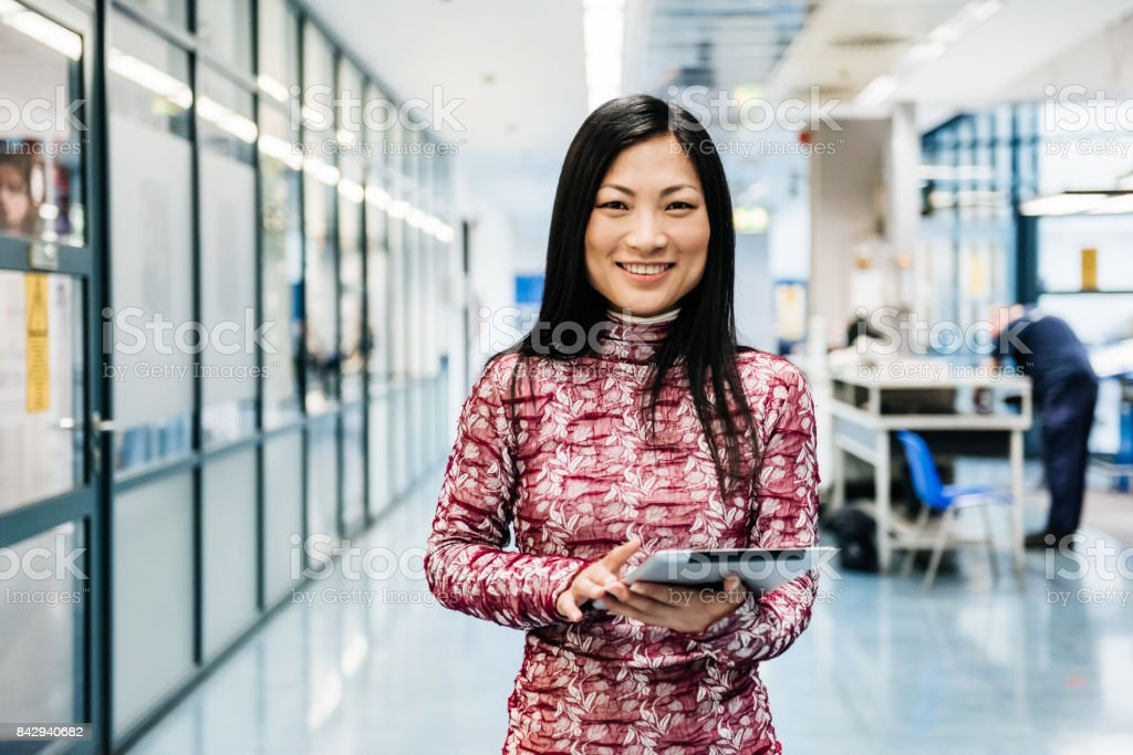 Asian Engineer With Digital Tablet In Factory stock photo