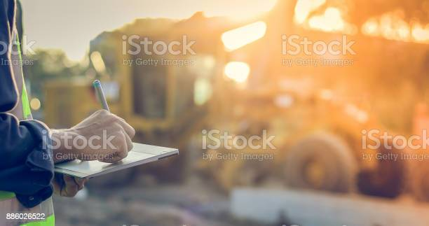 Asian engineer with hardhat using tablet pc computer inspecting and picture id886026522?b=1&k=6&m=886026522&s=612x612&h=1lzbm2wbe4wofdz3z0f hfo gmkqtwq41neglczad k=