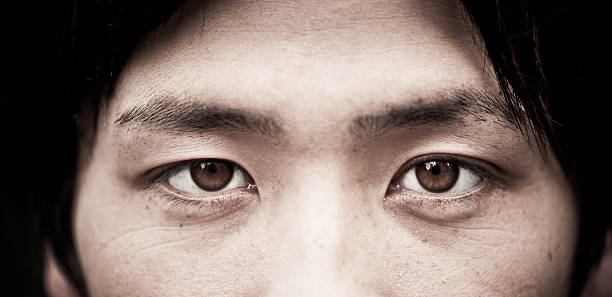 asian eyes close up - male eyes bildbanksfoton och bilder