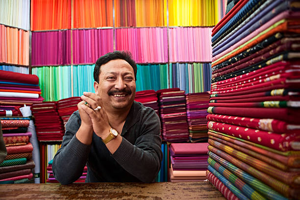 Asian fabric shop Colorful fabrics for sale, Asiahttp://bem.2be.pl/IS/nepal_380.jpg market vendor stock pictures, royalty-free photos & images