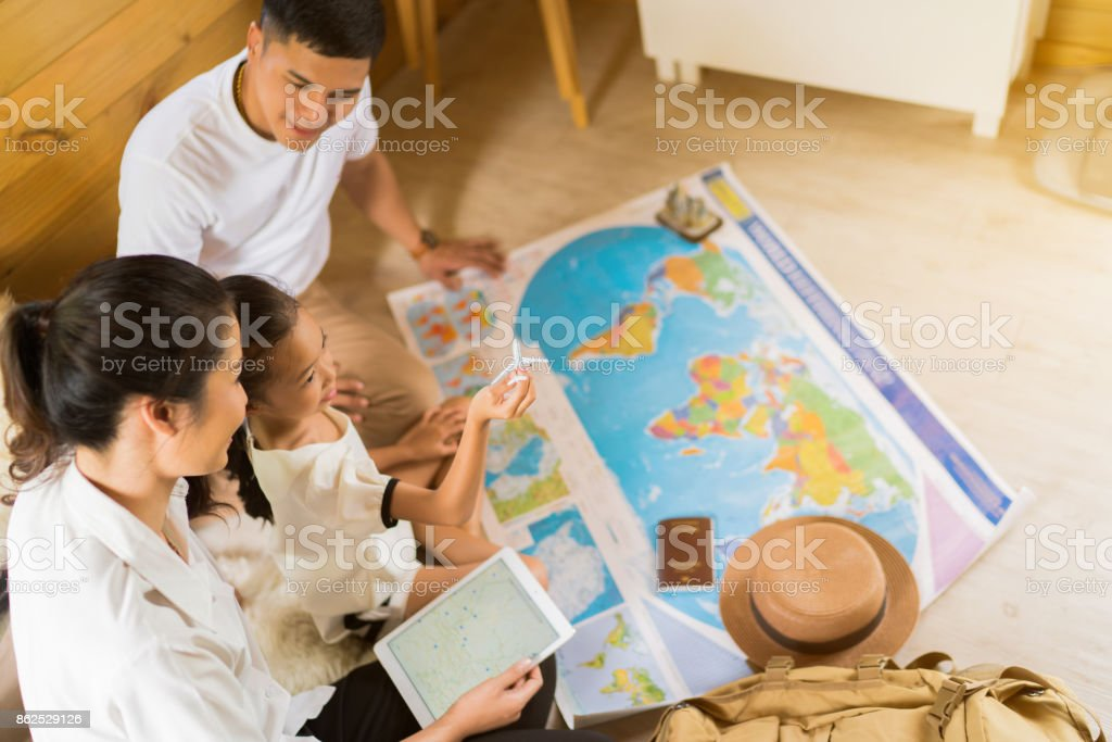 Asian family are planning to around the world. the image focus plane was carrying a child. stock photo