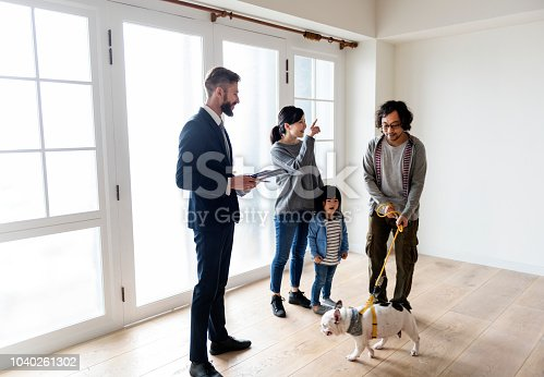 istock Asian family buy new house 1040261302