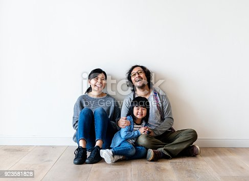 istock Asian family buy new house 923581828