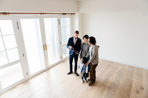 istock Asian family buy new house 929507266