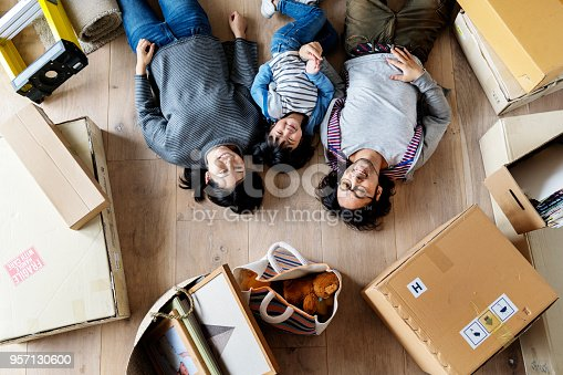 istock Asian family buy new house 957130600