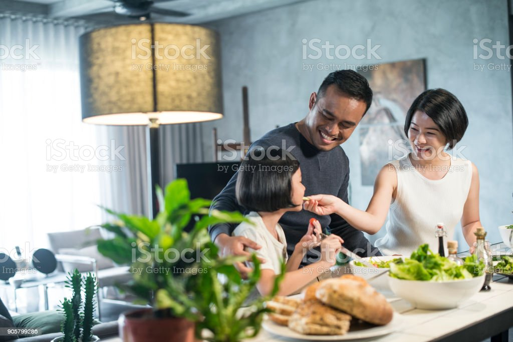 Asian family cooking at home. stock photo