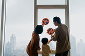 istock Asian family decorating home and prepare for Chinese New Year 1296443771