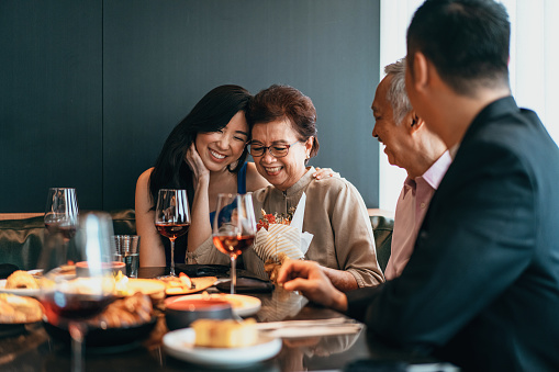 Asian family dining and celebrating Mother's day or birthday