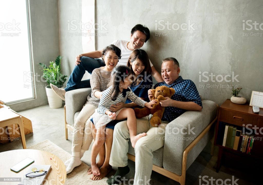 Asian family happiness togetherness at home stock photo