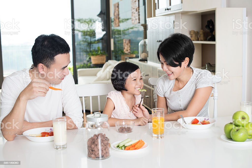 Asian Family Having Breakfast at Home stock photo
