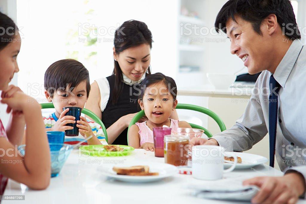 Asian Family Having Breakfast Before Husband Goes To Work stock photo