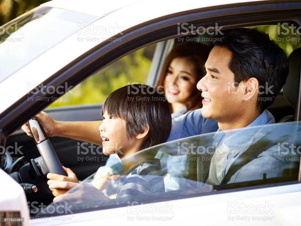 asian family having fun in car stock photo