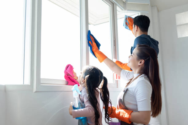Asian Family helping cleaning House together. Asian Family helping cleaning House together. Dad, Mom and daughter are wiping dust on windowsill. Having fun on Holidays. chores stock pictures, royalty-free photos & images
