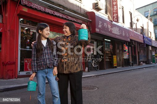 Asian family in front of store