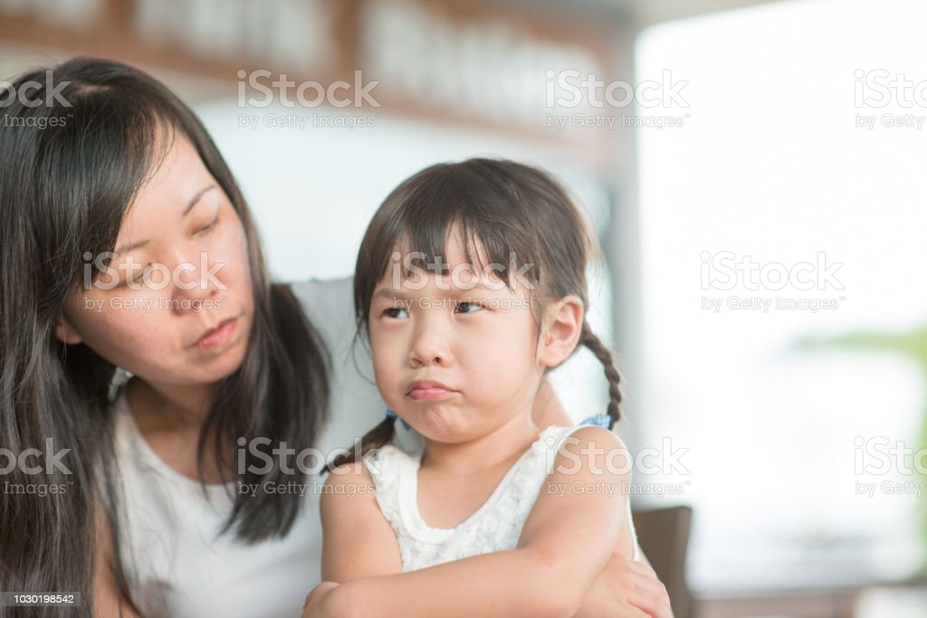 Asian family lifestyle at cafeteria stock photo