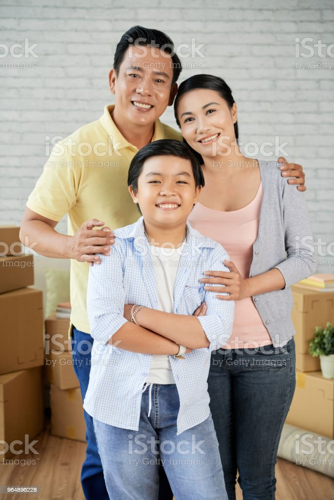Asian Family Moving to New Apartment royalty-free stock photo