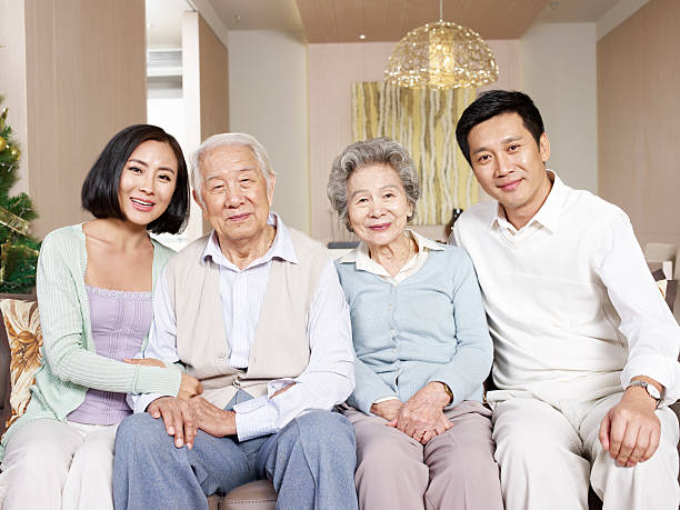 asian family home portrait of a happy asian family. old mother son asian stock pictures, royalty-free photos & images