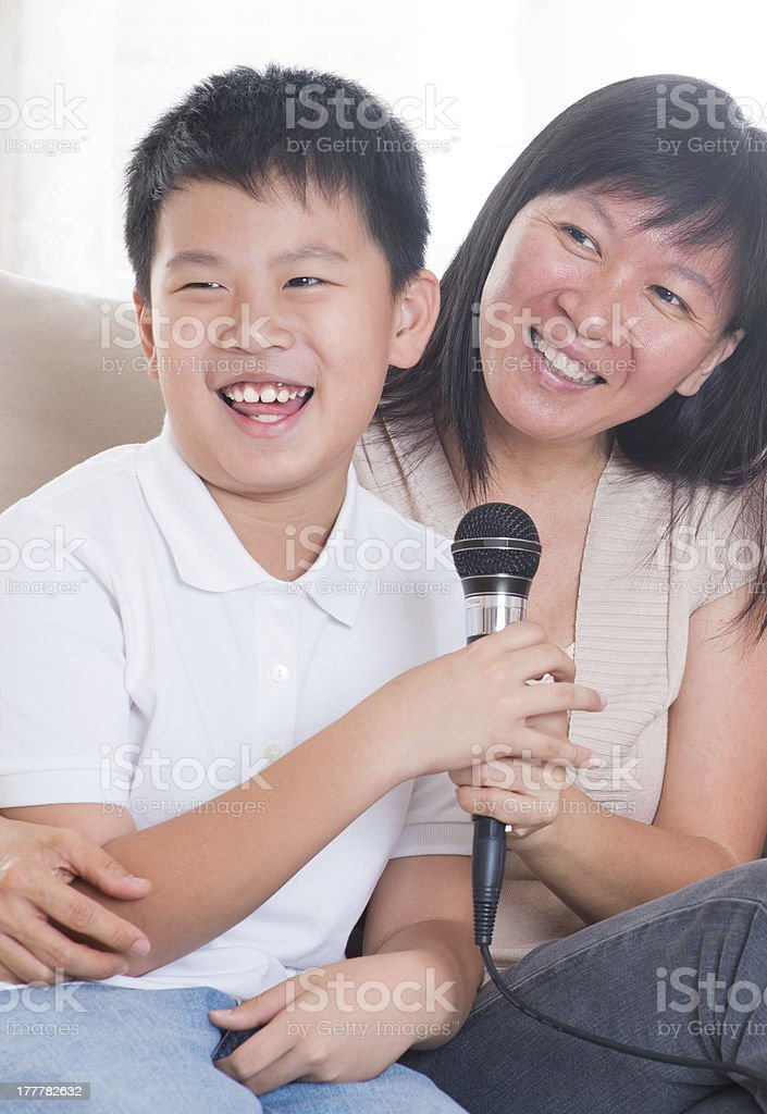 Asian family singing karaoke royalty-free stock photo