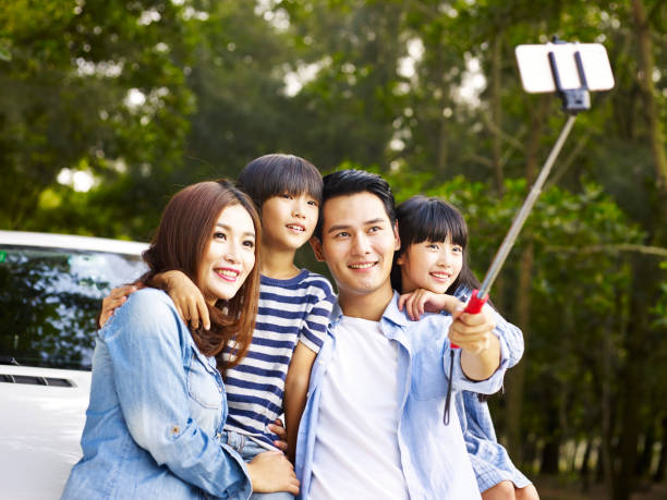 asian family taking a selfie stock photo