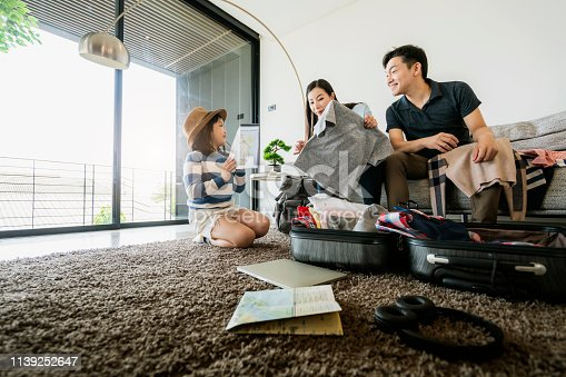 istock Asian Family travel concept happiness dad mom daughter packing stuff and planing for vacation trip with exited and joyful 1139252647