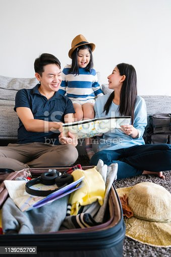 istock Asian Family travel concept happiness dad mom daughter packing stuff and planing for vacation trip with exited and joyful 1139252700