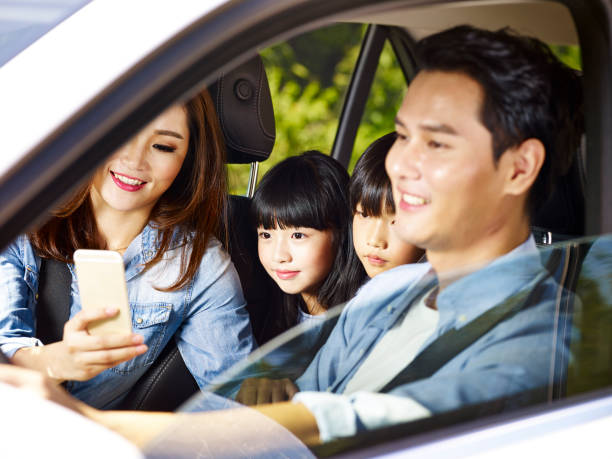 asian family traveling by car stock photo