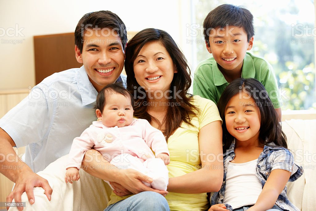 Asian family with baby royalty-free stock photo