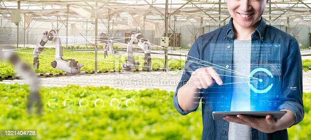 1096949092 istock photo Asian farmer growing plant with IOT based smart agriculture monitoring system, automate sensor robotic farming industry future internet of thing technology. 1221404728