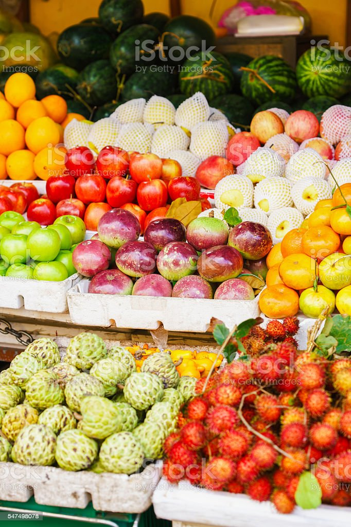 Asian farmer market selling Passion fruit and litchi stock photo