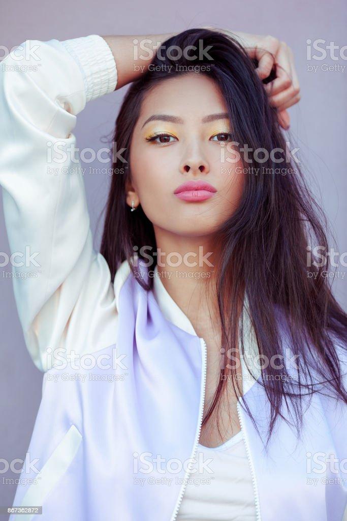 Asian fashion model closeup outdoors stock photo