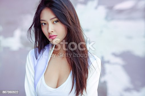 istock Asian fashion model outdoors 867360522