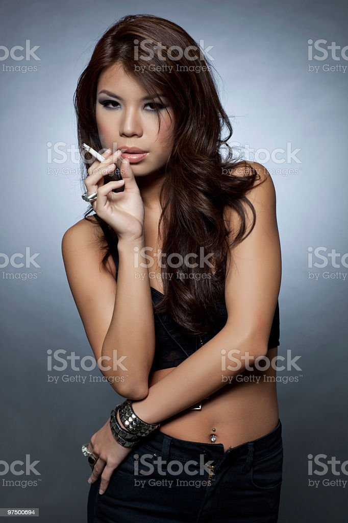 Asian fashion model with cigarette royalty-free stock photo