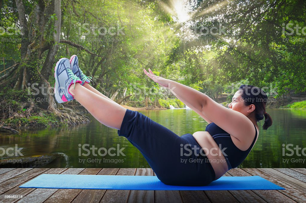 asian fat woman take v shape six pack course stock photo