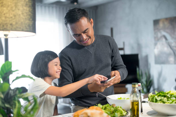 Asian father and daughter at home. stock photo