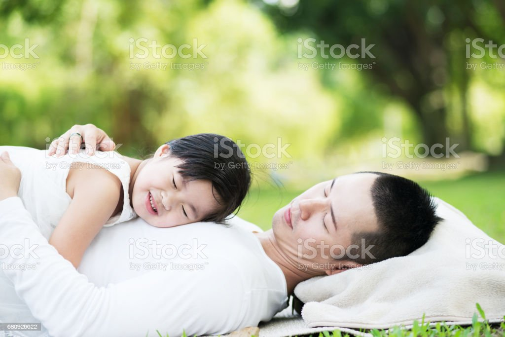 Asian Father and Daughter at the Park royalty-free stock photo