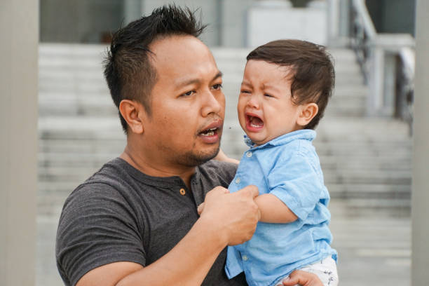 52 Father Comforting Son In Tears Stock Photos, Pictures & Royalty-Free  Images